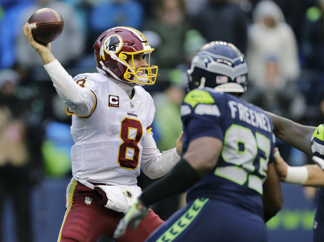 Washington Redskins quarterback Kirk Cousins passes under pressure from Seattle Seahawks defensive end Dwight Freeney (93) in the second half of an NFL football game, Sunday, Nov. 5, 2017, in Seat ...