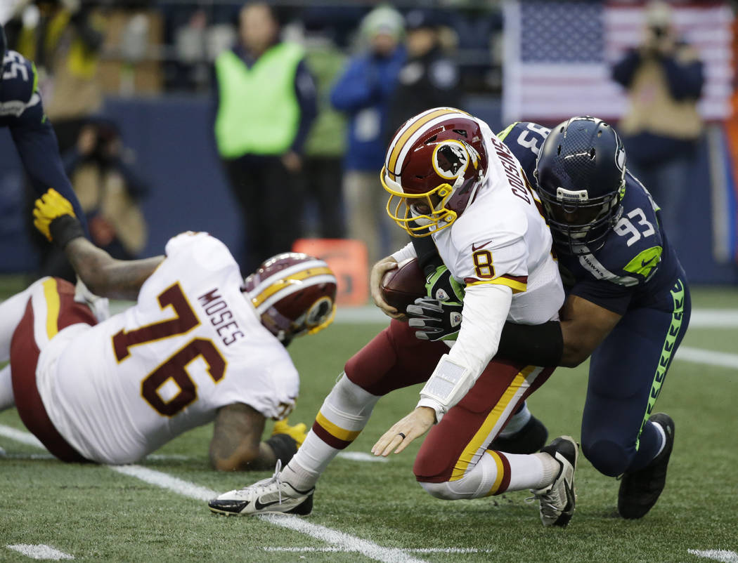 Seattle Seahawks defensive end Dwight Freeney (93) sacks Washington Redskins quarterback Kirk Cousins (8) in the second half of an NFL football game, Sunday, Nov. 5, 2017, in Seattle. (AP Photo/El ...