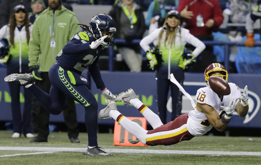 FILE - In this Sunday, Nov. 5, 2017, file photo, Washington Redskins wide receiver Josh Doctson, right, makes a diving catch ahead of Seattle Seahawks cornerback Shaquill Griffin, left, in the sec ...