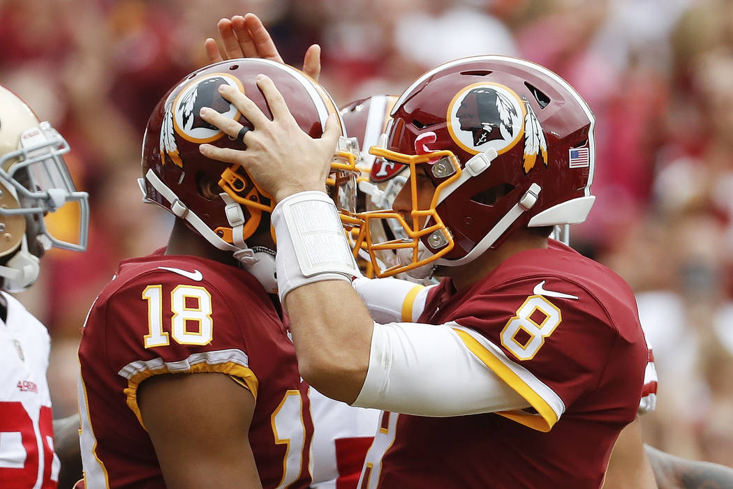 Washington Redskins quarterback Kirk Cousins (8) congratulates wide receiver Josh Doctson (18) after a touchdown during the first half of an NFL football game against the San Francisco 49ers in La ...