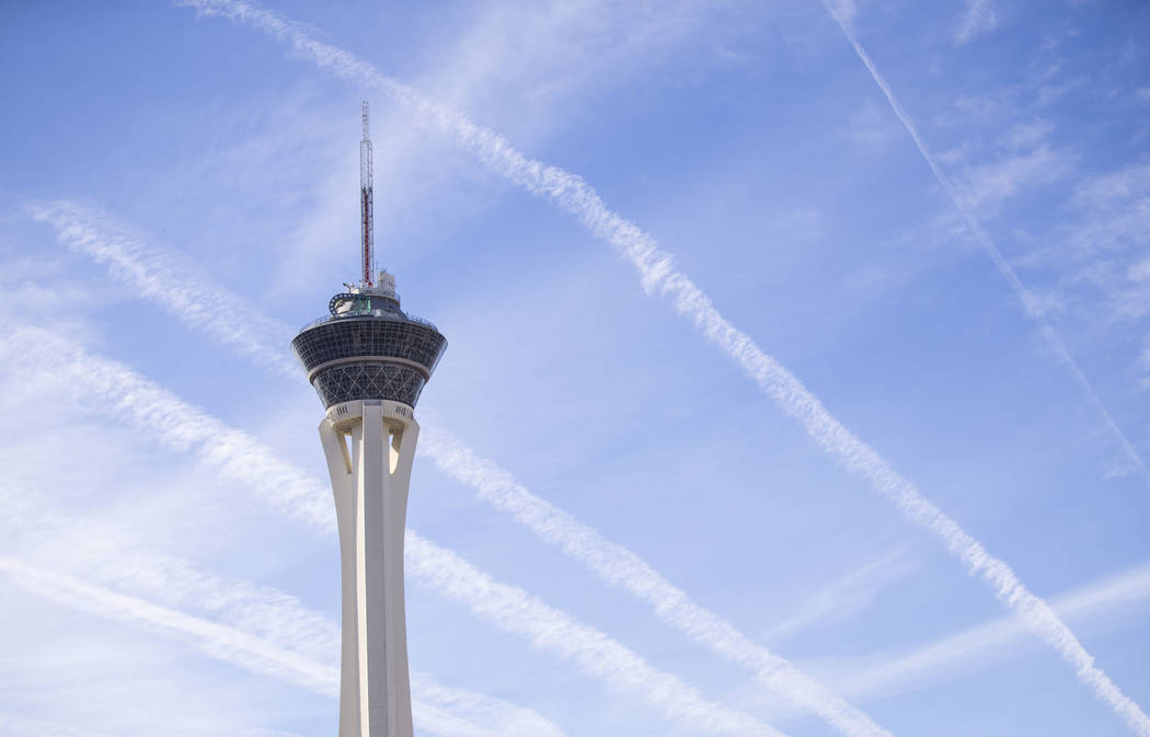 Vapor trails left behind by airplanes are seen above the Stratosphere tower in Las Vegas, Saturday, Nov. 11, 2017. Richard Brian Las Vegas Review-Journal @vegasphotograph