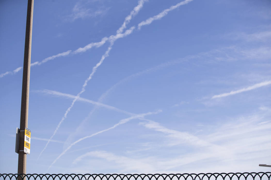 Vapor trails left behind by airplanes are seen above Las Vegas, Saturday, Nov. 11, 2017. Richard Brian Las Vegas Review-Journal @vegasphotograph
