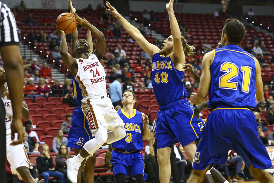 UNLV Rebels guard Jordan Johnson (24) shoots for a point past Alaska Nanooks forward Michael Kluting during an exhibition basketball game at the Thomas & Mack, Friday, Nov. 3, 2017. UNLV defea ...