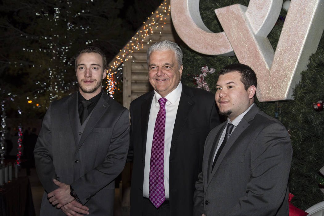 Clark County Commissioner Steve Sisolak is shown with Mandalay Bay security officer Jesus Campos and building engineer Stephen Schuck during the 26th annual Camelot gala at Opportunity Village's=M ...