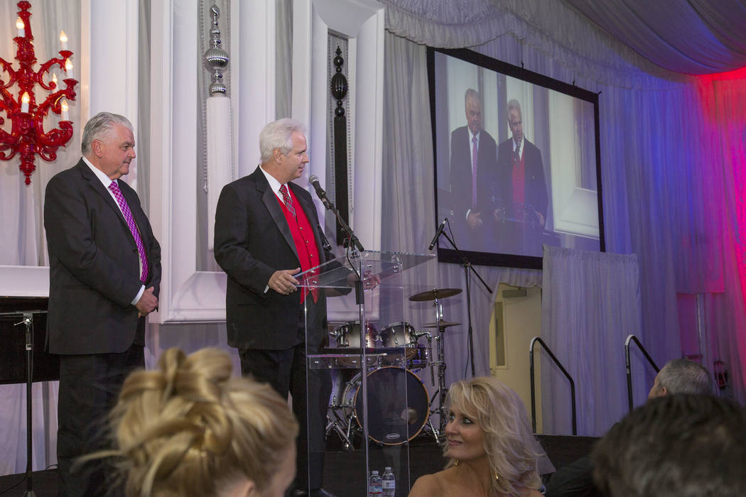Opportunity Village executive Bob Brown introduces Camelot gala honoree Clark Country Commissioner Steve Sisolak at the 26th annual fundraising event at Magical Forest on Thursday, Nov. 9, 2017. ( ...
