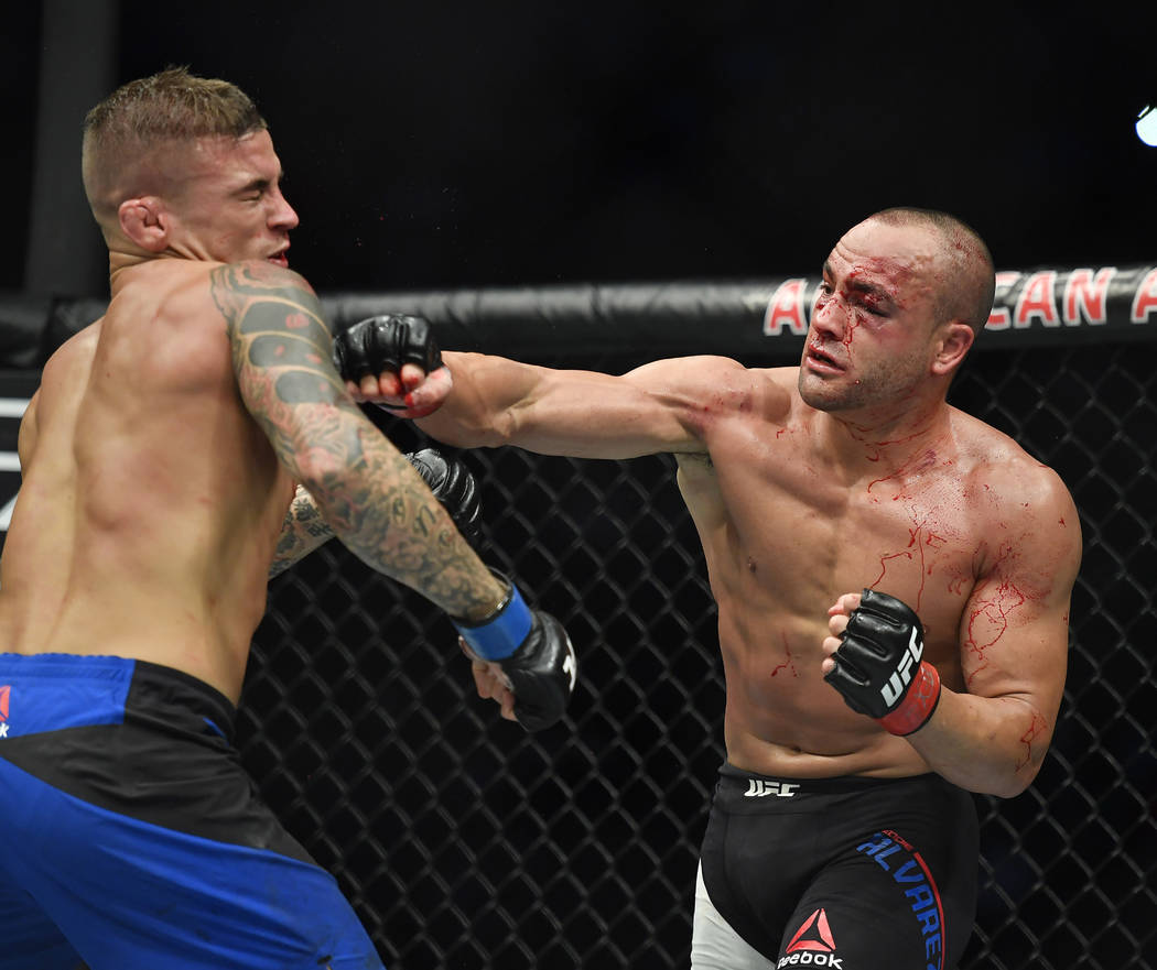 May 13, 2017; Dallas, TX, USA; Eddie Alvarez (red gloves) fights Dustin Poirier (blue gloves)  during UFC 211 at American Airlines Center. Mandatory Credit: Jerome Miron-USA TODAY Sports