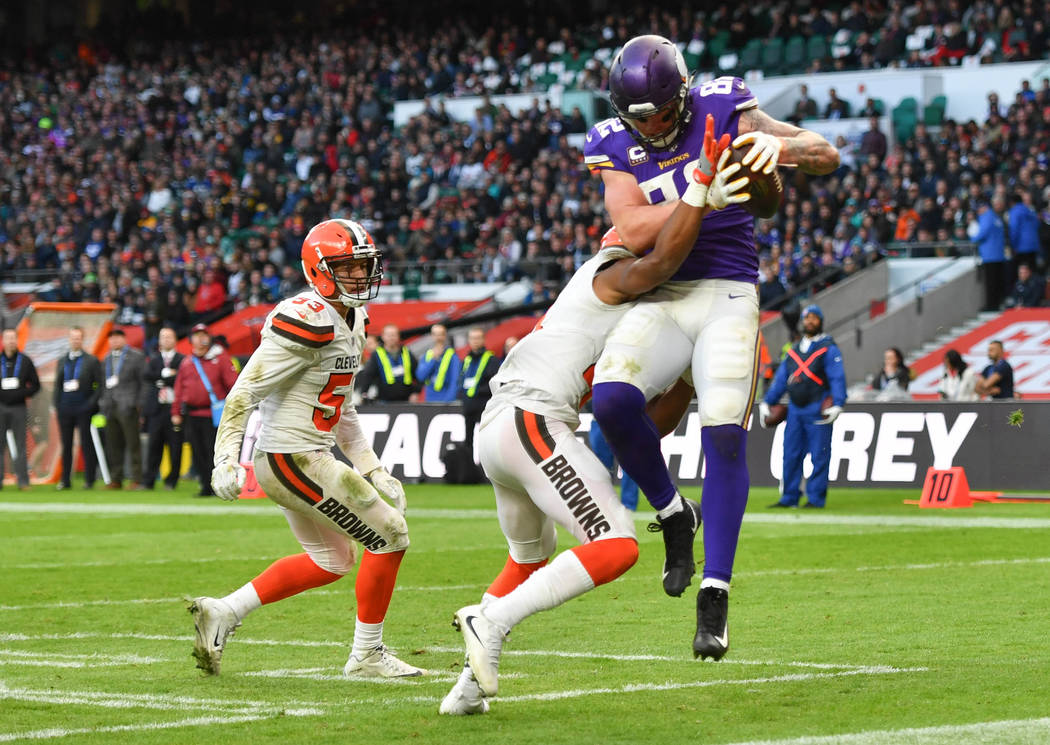 Oct 29, 2017; London, United Kingdom; Minnesota Vikings  tight end Kyle Rudolph (82) catches a 4 yard pass for a touchdown during the fourth quarter the NFL International Series game between the M ...