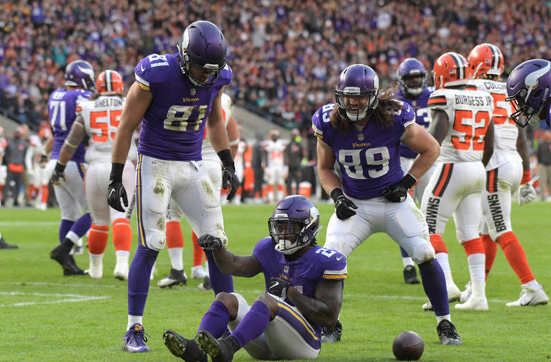 Oct 29, 2017; London, United Kingdom; Minnesota Vikings running back Jerick McKinnon (21) celebrates with tight ends Blake Bell (81) and David Morgan (89) after scoring on a 1-yard touchdown run a ...