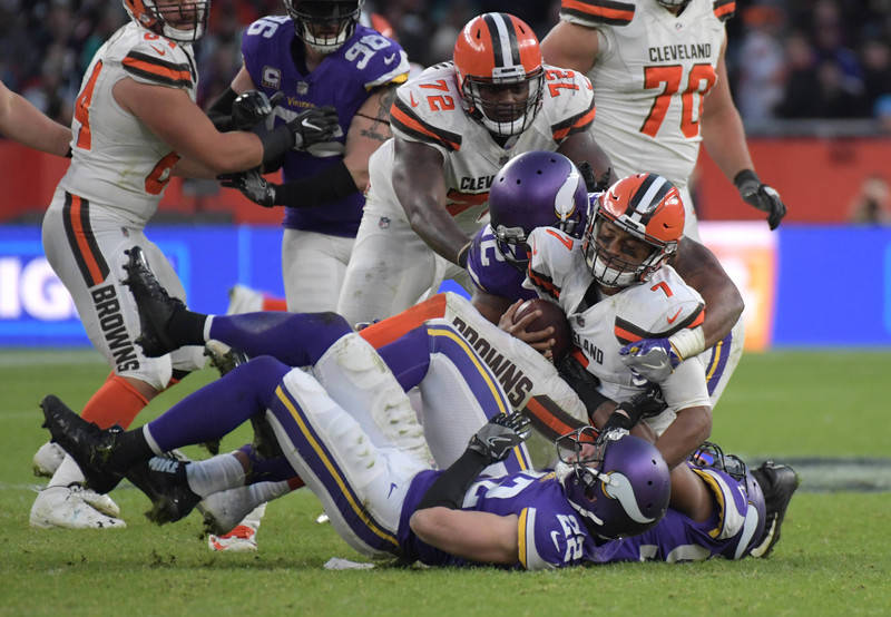 Oct 29, 2017; London, United Kingdom; Cleveland Browns quarterback DeShone Kizer (7) is sacked by Minnesota Vikings defensive end Everson Griffen (97), free safety Harrison Smith (22) and cornerba ...