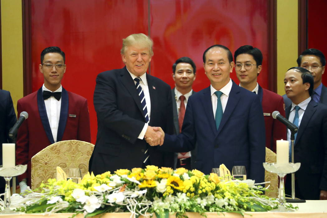 President Donald Trump, centre left and Vietnamese President Tran Dai Quang attend a State Dinner at the International Convention Center, Saturday, Nov. 11, 2017, in Hanoi, Vietnam. (AP Photo/Andr ...