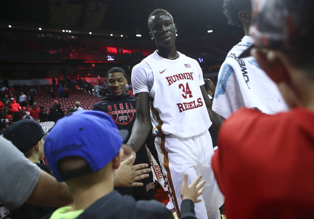 UNLV's Cheikh Mbacke Diong (34) high-fives fans after defeating Florida A&M in a basketball game at the Thomas & Mack Center in Las Vegas on Saturday, Nov. 11, 2017. Chase Stevens Las Vega ...