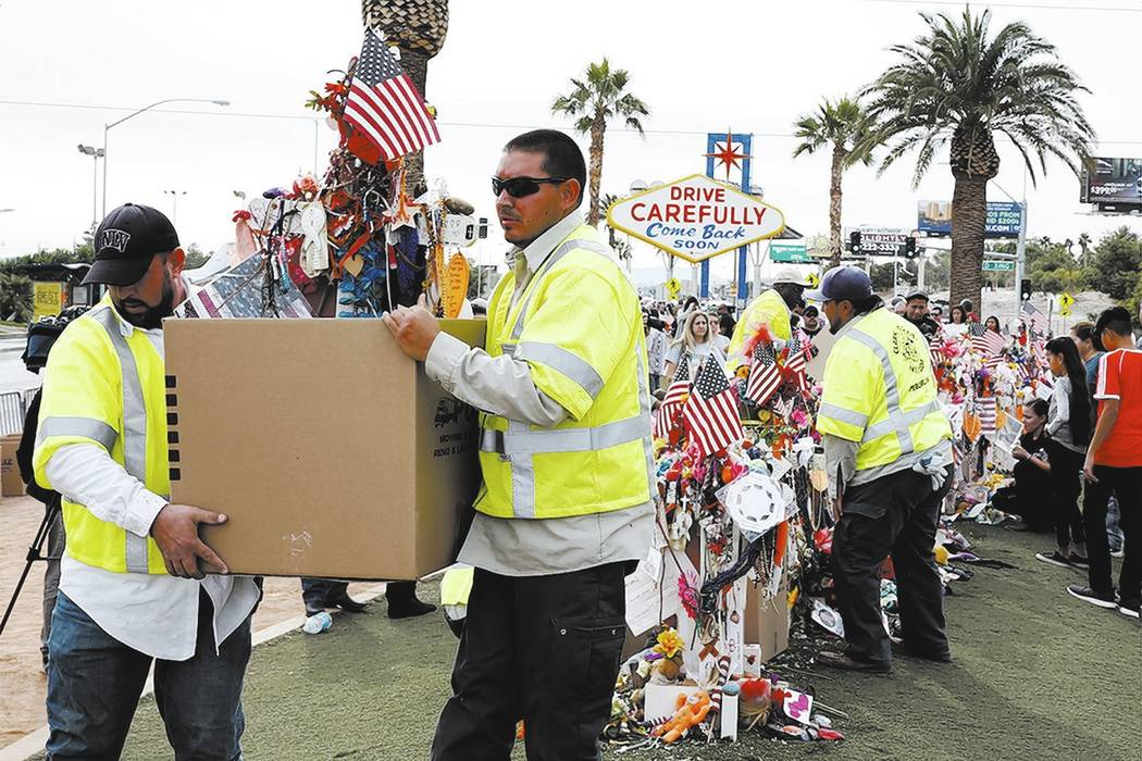 Clark County employees box up crosses and items from the Route 91 Harvest festival memorial and load them onto trucks, which will take the items to the Clark County Museum at 1830 S. Boulder Highw ...