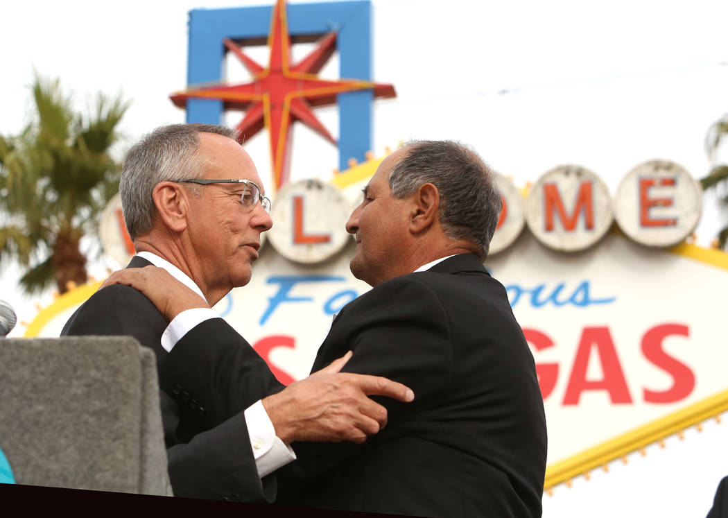 Jim Gibson, Clark County Commissioner, left, congratulates Greg Zanis after declaring Sunday ҇reg Zanis DayӠat the Route 91 Harvest memorial at the Welcome to Fabulous Las Vegas sign S ...