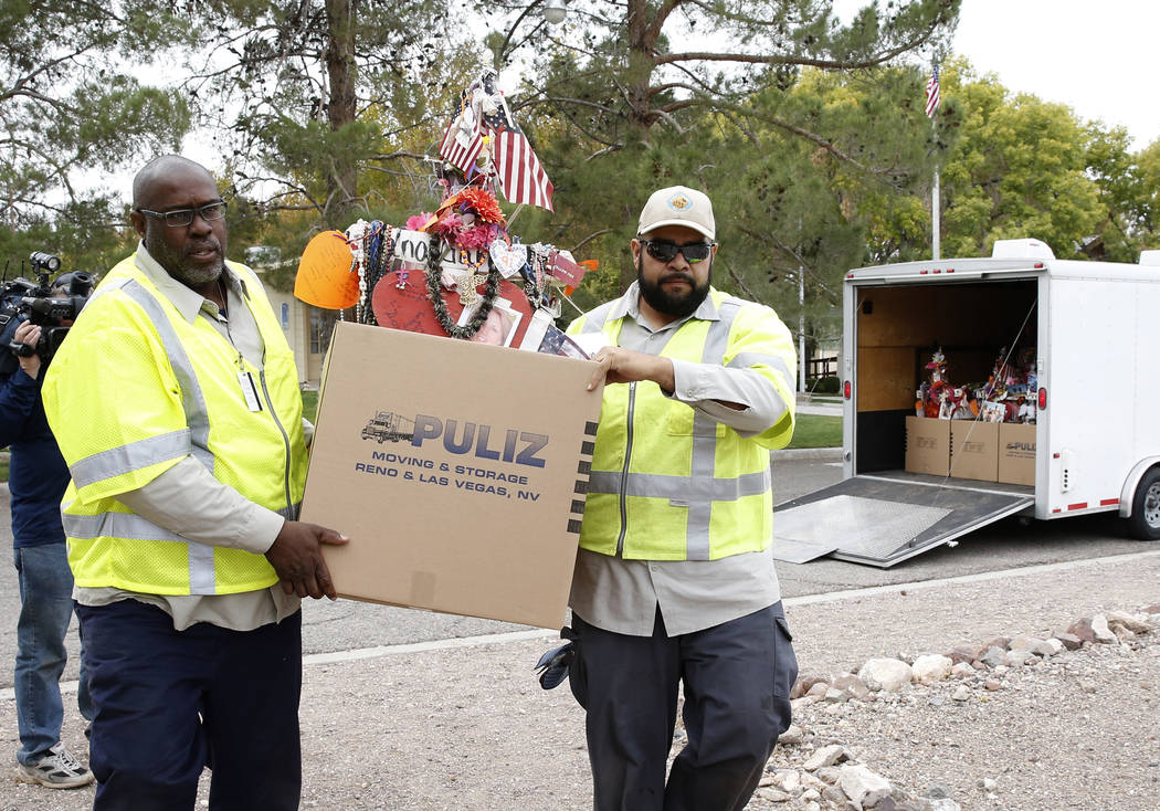 Clark County employees unload crosses and items from a truck at the clark County Museum in Henderson Sunday, Nov. 12, 2017. Fifty eight crosses and items that were erected in honor of the Oct. 1 s ...