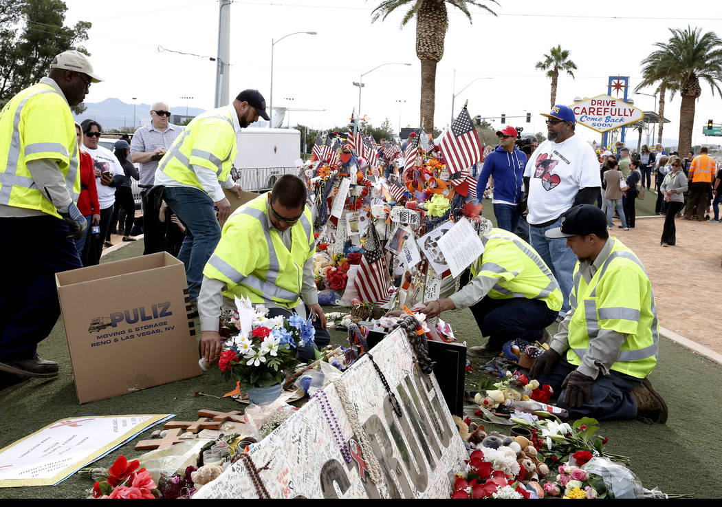Clark County employees box up crosses and items from the Route 91 Harvest festival memorial and load them onto trucks at the Route 91 Harvest memorial at the Welcome to Fabulous Las Vegas sign Nov ...