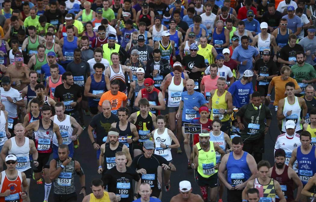 Race participants pass the start line during the Rock 'n' Roll Marathon in Las Vegas on Sunday, Nov. 13, 2016. (Chase Stevens/Las Vegas News Bureau)