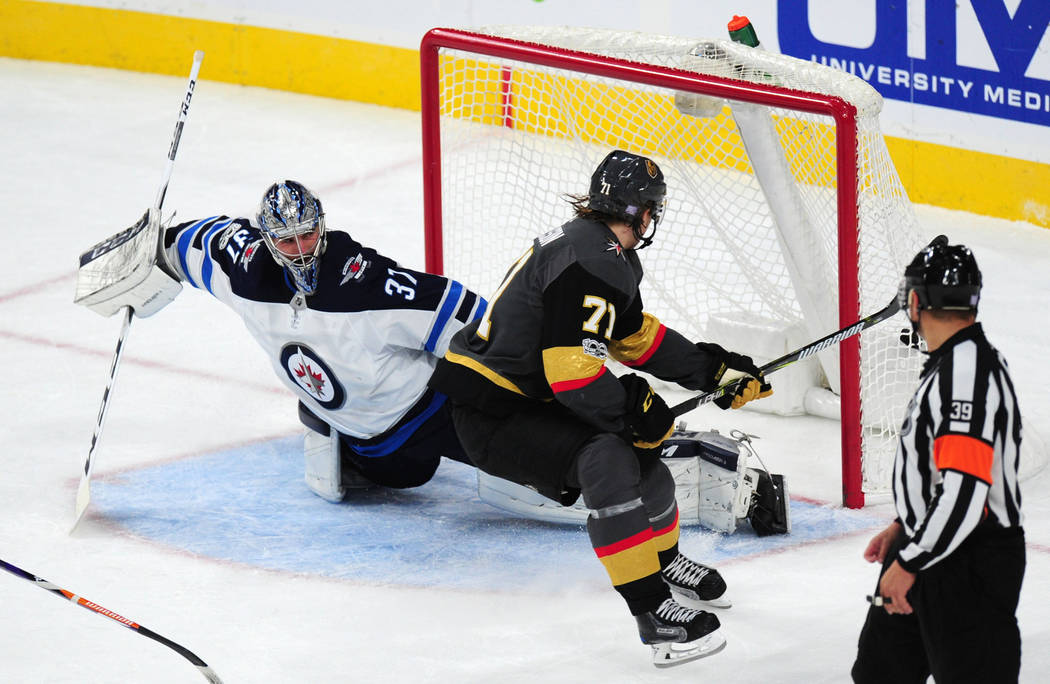 Vegas Golden Knights forward William Karlsson scores a short-handed goal on a breakaway against Winnipeg Jets goaltender Connor Hellebuyck in the second period of their NHL hockey game at T-Mobile ...