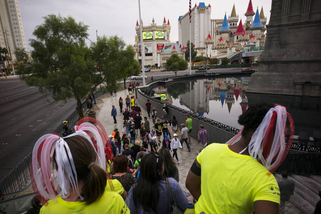 Amanda Bailey, left, and Girldy Janiton (cq), both of the Montreal, Canada area, take in the scene before the start of the Rock 'n' Roll Marathon outside of the New York New York in Las Vegas on S ...