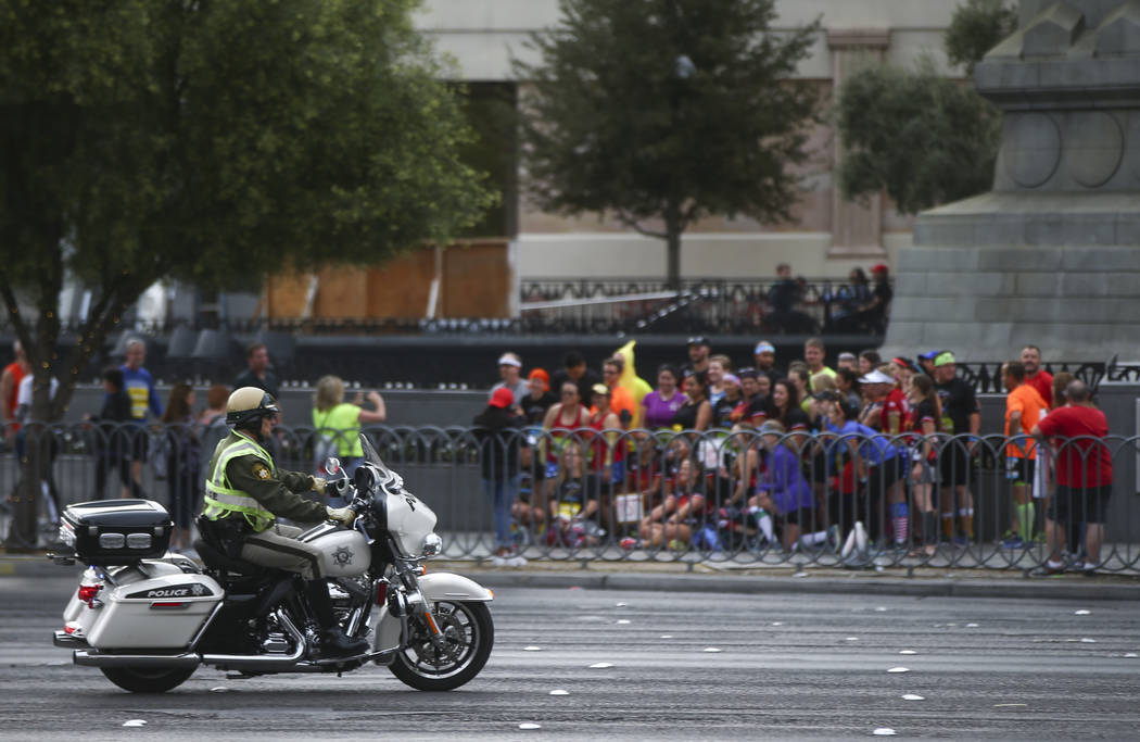 Las Vegas police officers help shut down the Las Vegas Strip to traffic before the start of the Rock 'n' Roll Marathon in Las Vegas on Sunday, Nov. 12, 2017. Chase Stevens Las Vegas Review-Journal ...