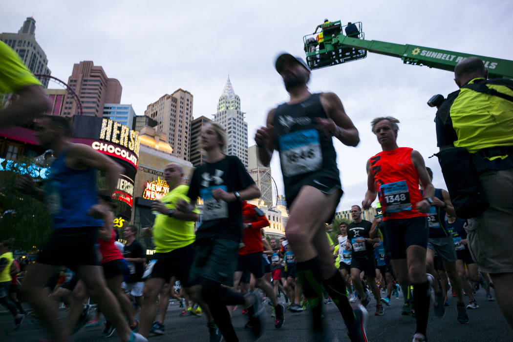 Participants head out from the start line outside of the New York-New York at the beginning of the Rock 'n' Roll Marathon in Las Vegas on Sunday, Nov. 12, 2017. Chase Stevens Las Vegas Review-Jour ...