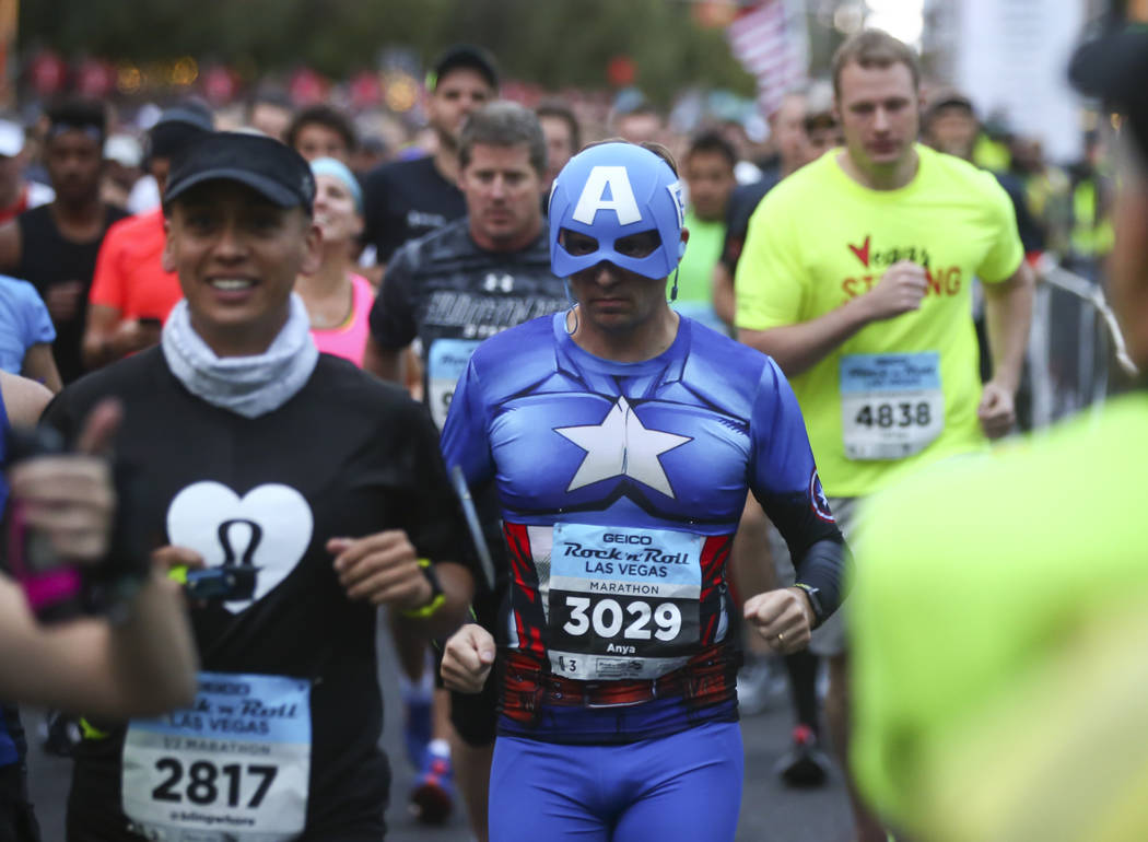 Adam Sturdy of London heads out from the start line outside of the New York-New York at the beginning of the Rock 'n' Roll Marathon in Las Vegas on Sunday, Nov. 12, 2017. Chase Stevens Las Vegas R ...