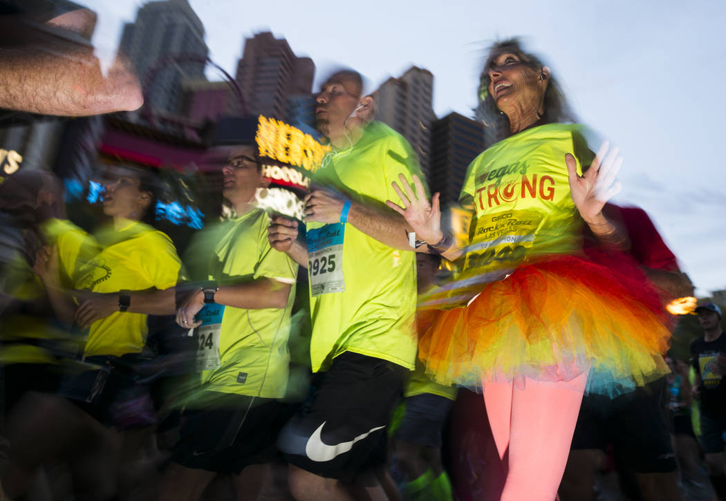 Half marathon participant Kandice Westenberger of Redlands, Calif., right, heads out from the start of the Rock 'n' Roll Marathon in Las Vegas on Sunday, Nov. 12, 2017. Chase Stevens Las Vegas Rev ...