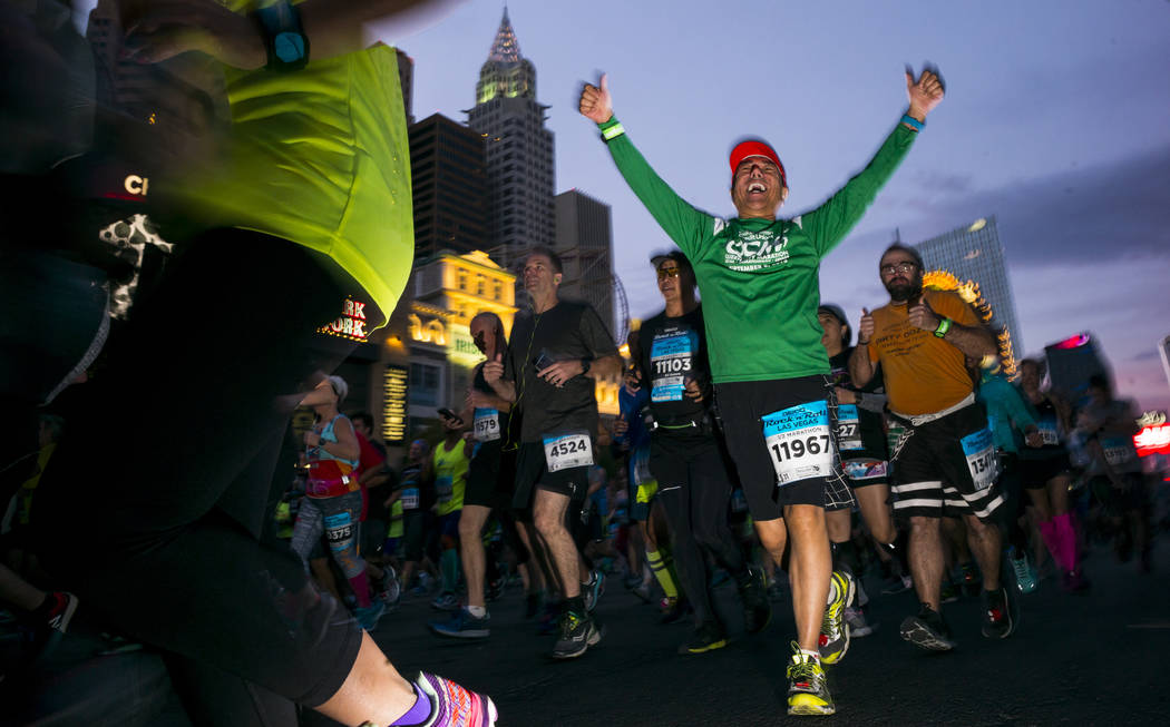 Half marathon participant Benjamin Hernando, center right,  heads out from the start of the Rock 'n' Roll Marathon in Las Vegas on Sunday, Nov. 12, 2017. Chase Stevens Las Vegas Review-Journal @cs ...