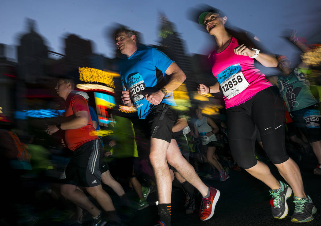 Half marathon participants Timothy O'Shea Jr. of Nyack, N.Y.., and Mary Hannapel of Otsego, Mich. head out from the start of the Rock 'n' Roll Marathon in Las Vegas on Sunday, Nov. 12, 2017. Chase ...
