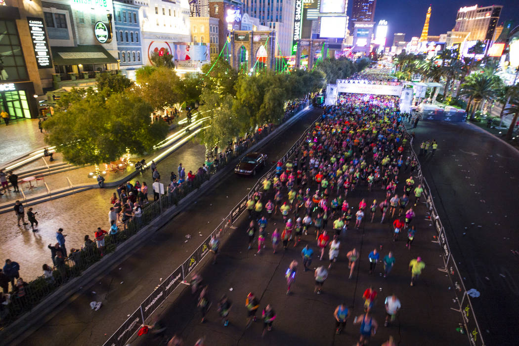 Half marathon participants head out from the start of the Rock 'n' Roll Marathon in Las Vegas on Sunday, Nov. 12, 2017. Chase Stevens Las Vegas Review-Journal @csstevensphoto
