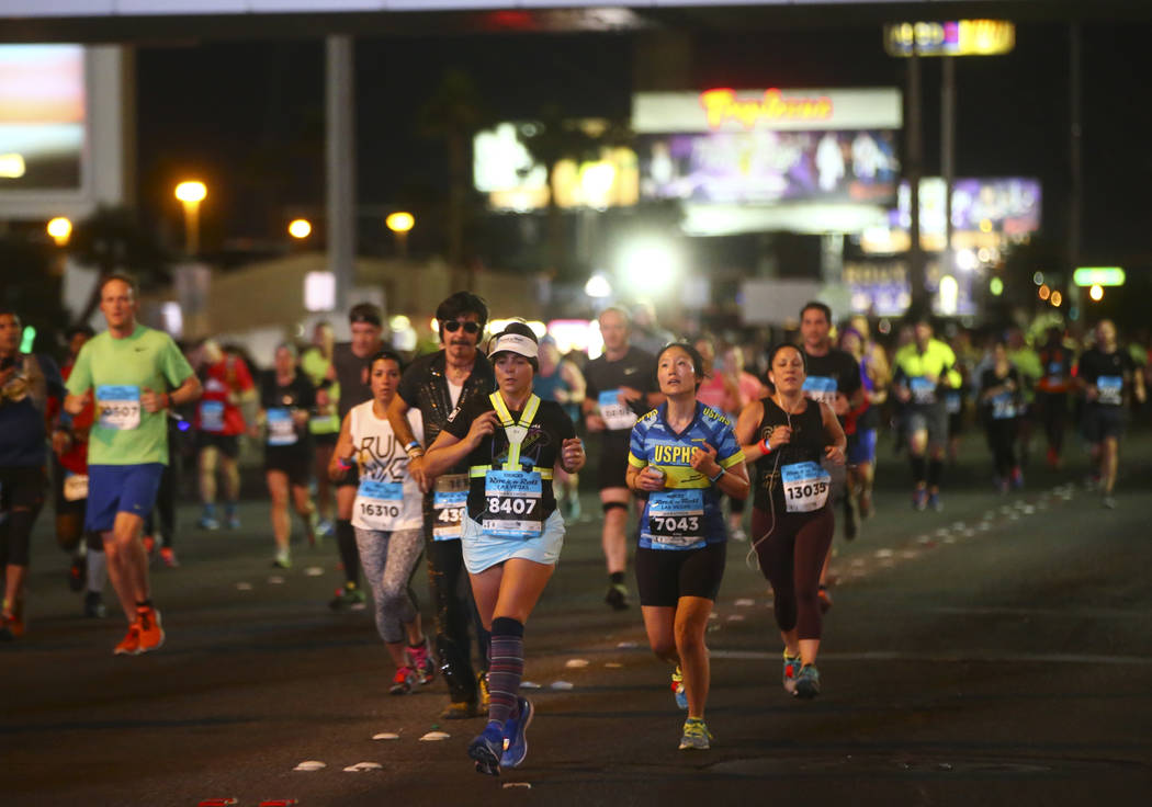 Tania Alves of Las Vegas, center left, passes Tropicana Avenue during the Rock 'n' Roll Marathon in Las Vegas on Sunday, Nov. 12, 2017. Chase Stevens Las Vegas Review-Journal @csstevensphoto