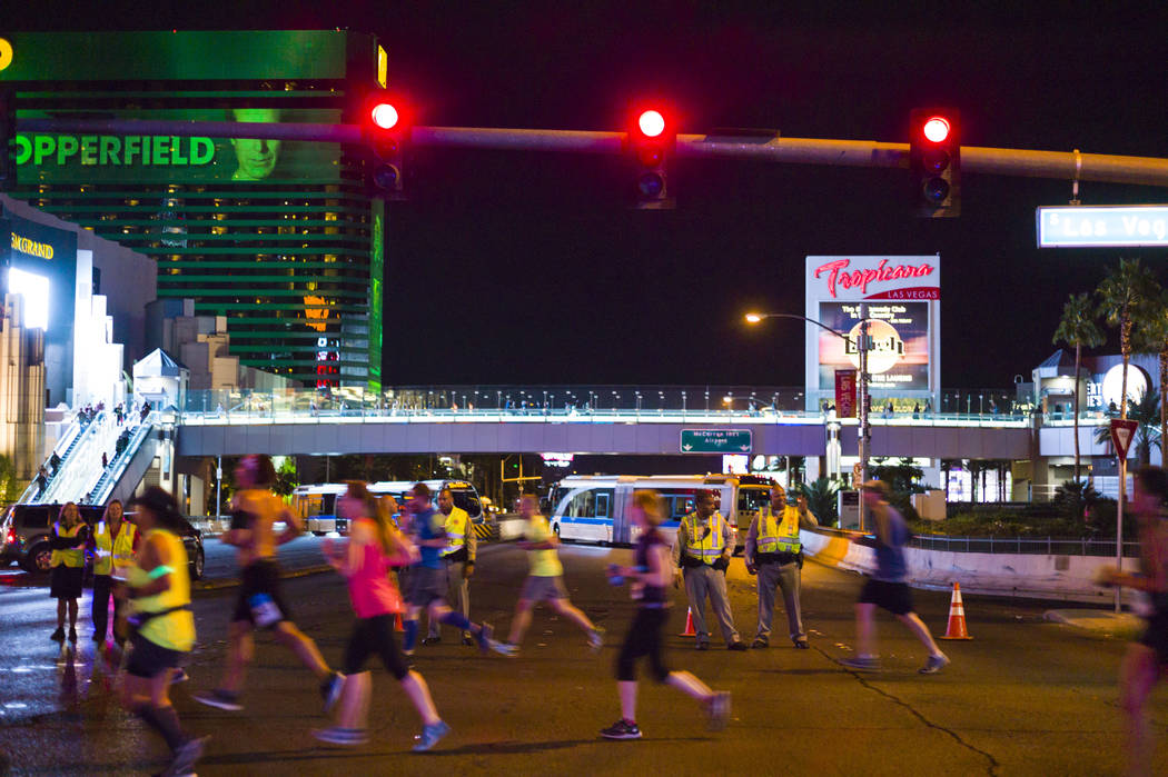 Las Vegas police officers watch as race participants pass by Tropicana Avenue during the Rock 'n' Roll Marathon in Las Vegas on Sunday, Nov. 12, 2017. Chase Stevens Las Vegas Review-Journal @csste ...