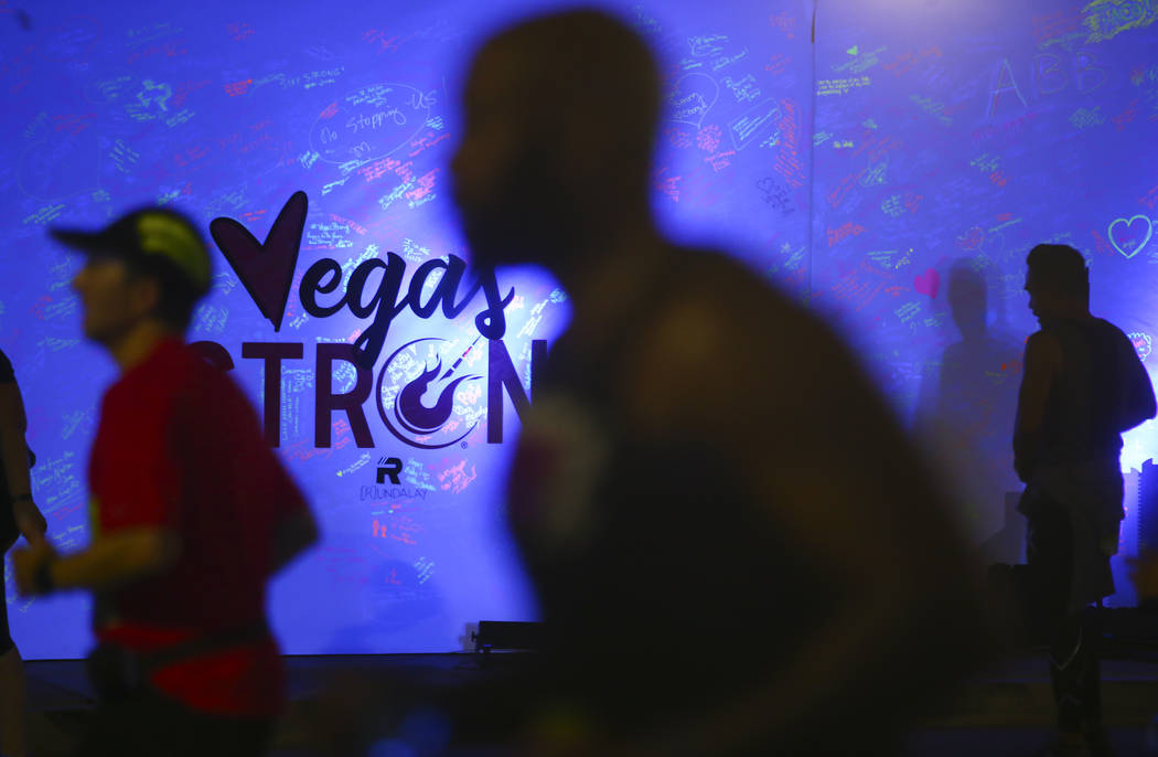 Race participants pass a memorial wall in honor of victims of the Oct. 1 shooting during the Rock 'n' Roll Marathon in Las Vegas on Sunday, Nov. 12, 2017. Chase Stevens Las Vegas Review-Journal @c ...