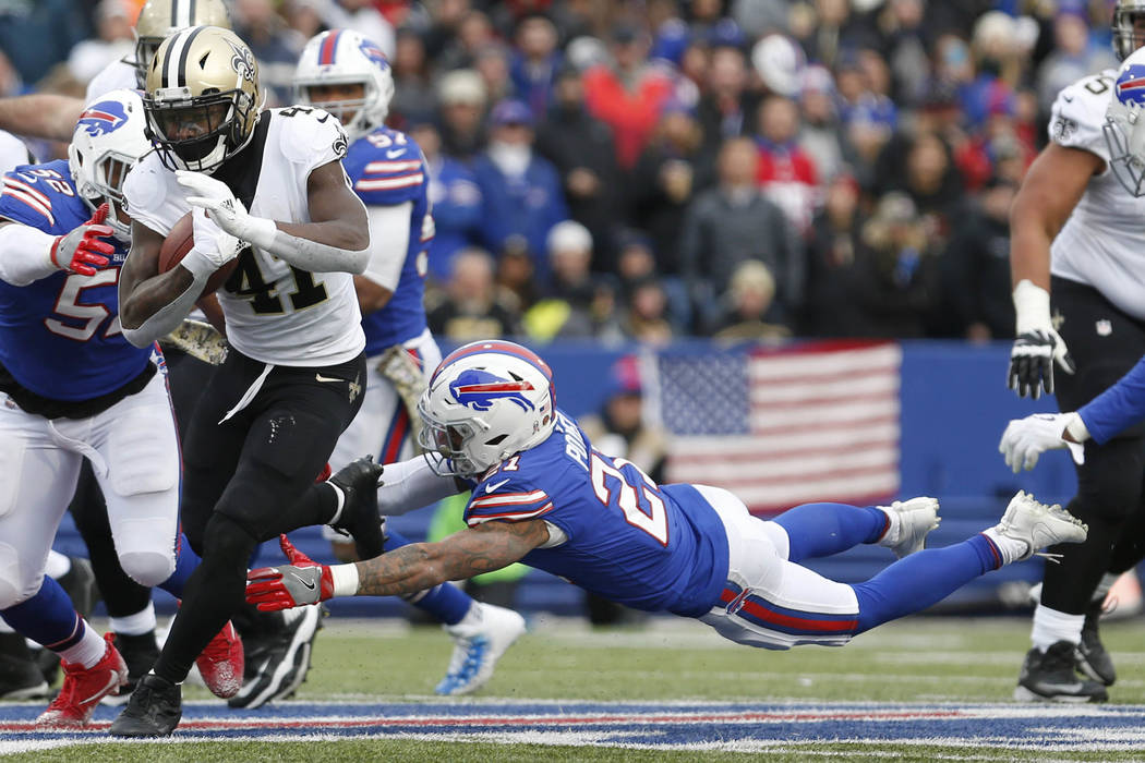 Nov 12, 2017; Orchard Park, NY, USA; Buffalo Bills free safety Jordan Poyer (21) dives to try and make a tackle on New Orleans Saints running back Alvin Kamara (41) during the second half at New E ...