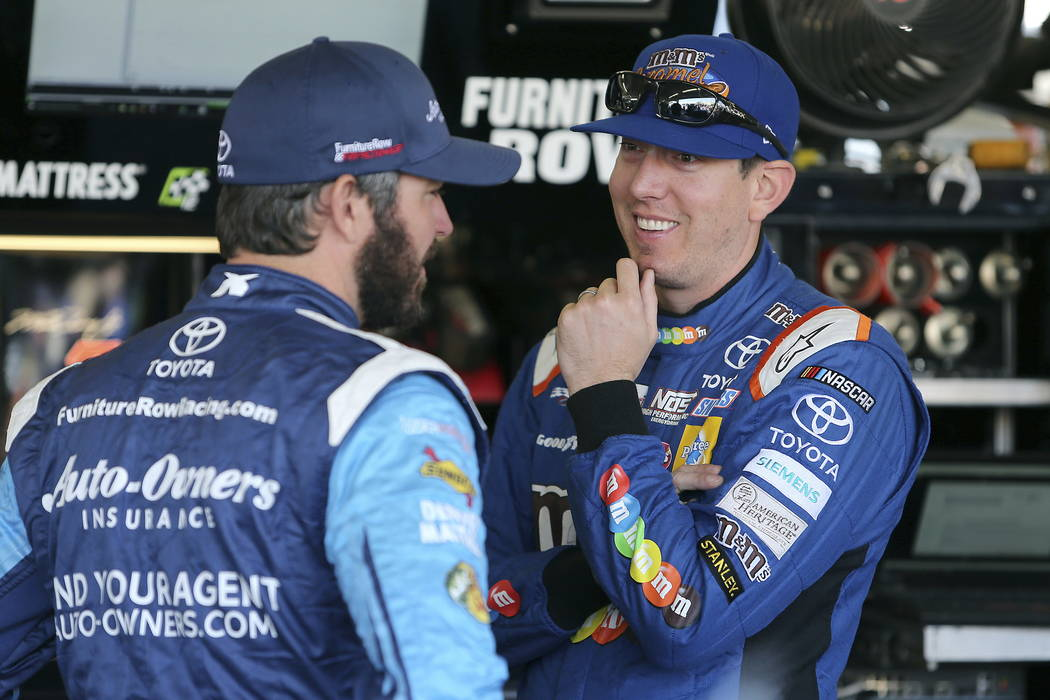 Kyle Busch, right, talks with Martin Truex Jr. in the garage area before practice for the NASCAR Cup Series auto race at Phoenix International Raceway, Friday, Nov. 10, 2017, in Avondale, Ariz. Bo ...