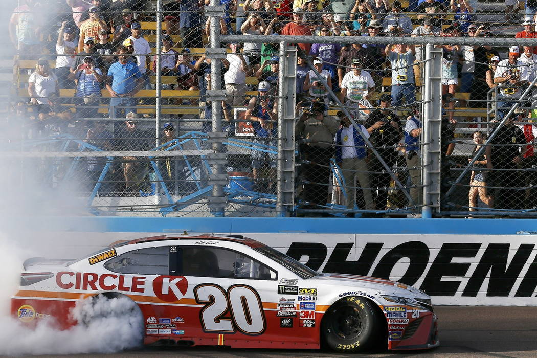 Matt Kenseth celebrates his win after a NASCAR Cup Series auto race as he does a burnout at the finish line at Phoenix International Raceway Sunday, Nov. 12, 2017, in Avondale, Ariz. (AP Photo/Ros ...