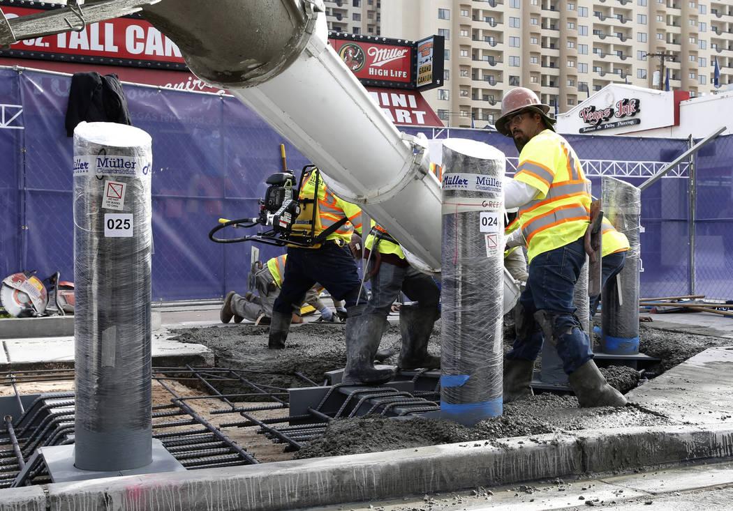 Construction crews pour cement where they began installing steel posts on the Strip near Aria Monday, Nov. 13, 2017, to protect pedestrians along Las Vegas Boulevard. (Bizuayehu Tesfaye/Las Vegas  ...