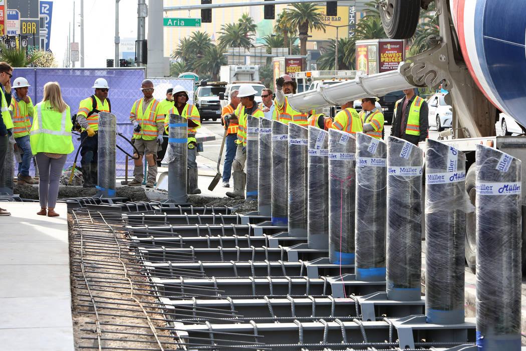 Construction crews began installing steel posts on the Strip near Aria on Monday, Nov. 13, 2017, to protect pedestrians along Las Vegas Boulevard. (Bizuayehu Tesfaye/Las Vegas Review-Journal) @biz ...
