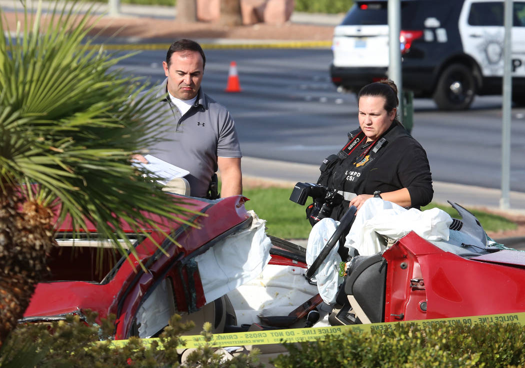 Las Vegas police investigate a crash that has closed the intersection of Sahara Avenue and Durango Drive in Las Vegas, Monday, Nov. 13, 2017. The female driver of the sedan was hospitalized in cri ...