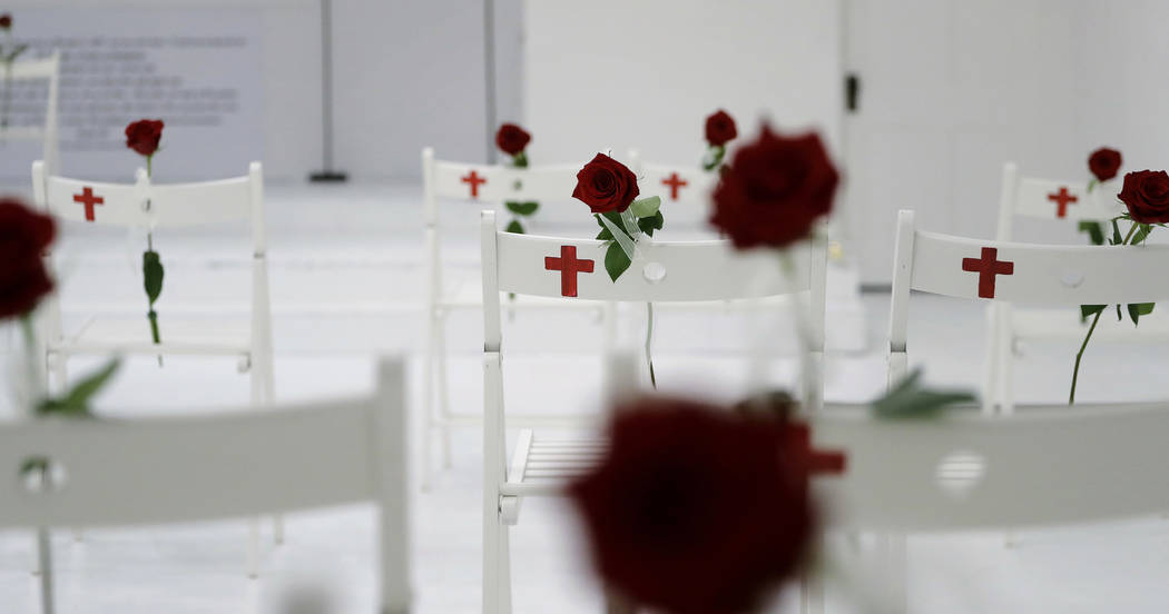A memorial for the victims of the shooting at Sutherland Springs First Baptist Church, including 26 white chairs each painted with a cross and and rose, is displayed in the church Sunday, Nov. 12, ...