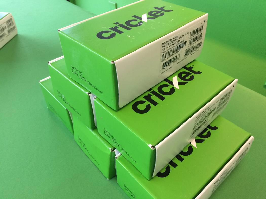 Some of the cell phones, still in their packaging, are seen Nov. 7, 2017, at the Cricket Wireless store, 2051 N. Rainbow Blvd. The phone store gave a dozen new cell phones to the rape crisis cente ...