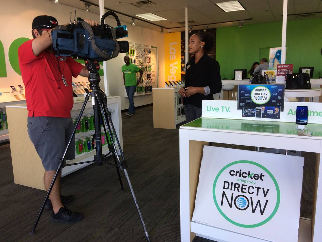Channel 13 interviews Carmella Gadsen, development coordinator for the Rape Crisis Center, Nov. 7, 2017, at Cricket Wireless store, 2051 N. Rainbow Blvd.  The nonprofit was given 12 new smart phon ...