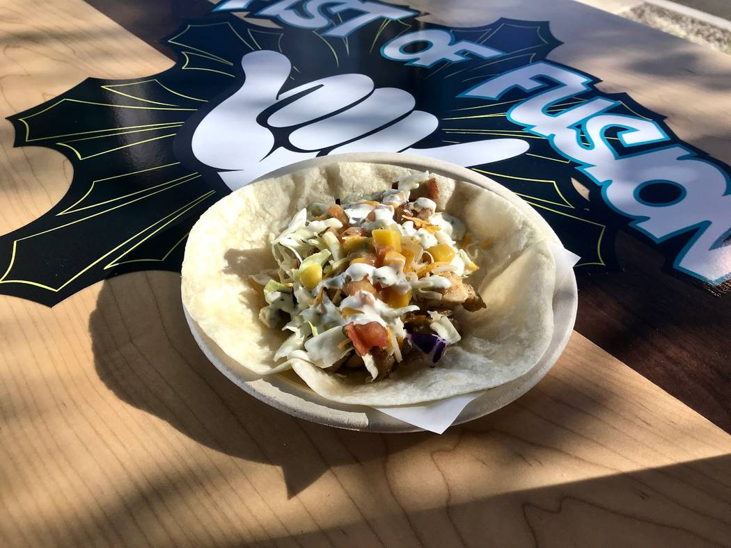 Island mango chicken taco ($3) with grilled chicken, mango-avocado salsa, cabbage, cheddar cheese and cilantro-lime dressing. (Madelyn Reese/View) @MadelynGReese