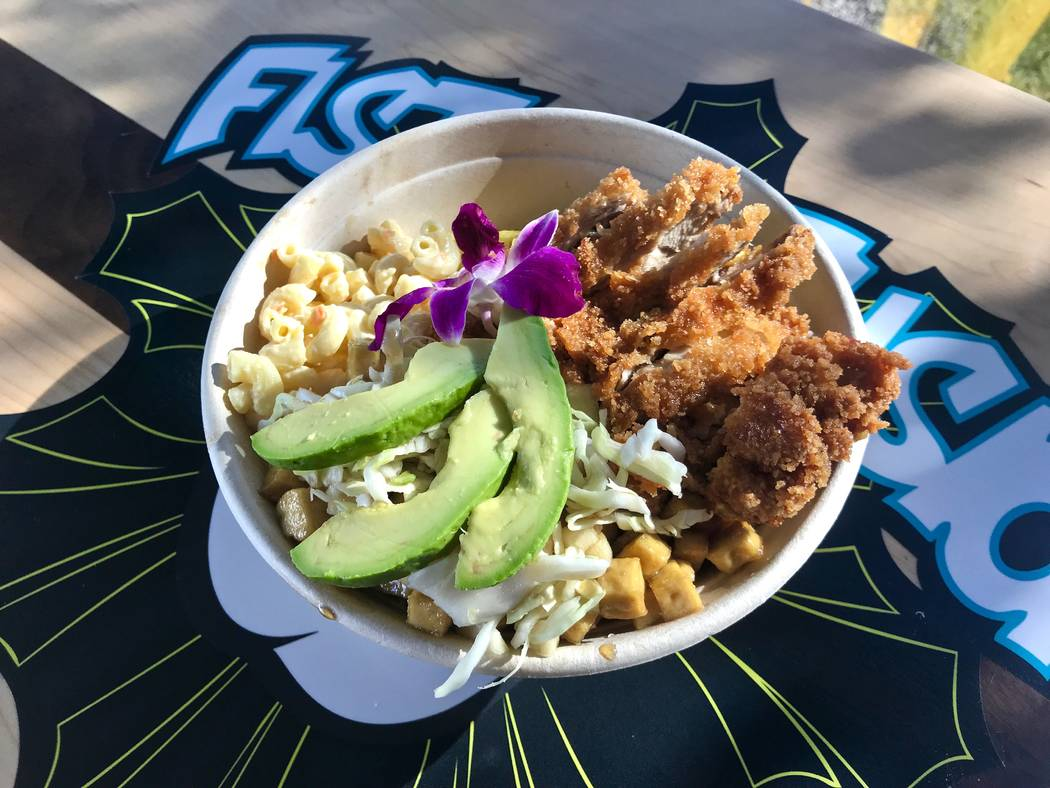 An island rice bowl with honey sesame tofu and sesame chicken, brown rice, grilled pineapple and macaroni salad ($10). (Madelyn Reese/View) @MadelynGReese