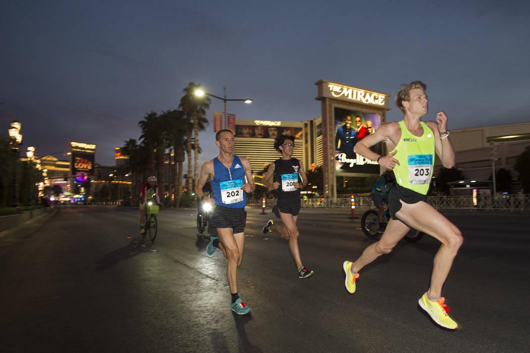 Early leaders in the half-marathon race, including winner Jeffrey Eggleston in bib No. 202, head north on the Strip during the Rock 'n' Roll Las Vegas Marathon. (Sam Morris Las Vegas News Bureau)N ...