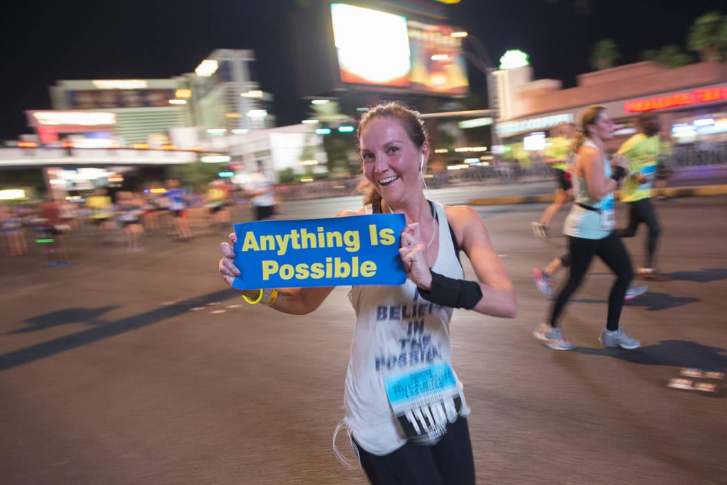 A woman shows off an inspirational poster during the Rock 'n' Roll Las Vegas Marathon. (Sam Morris Las Vegas News Bureau)