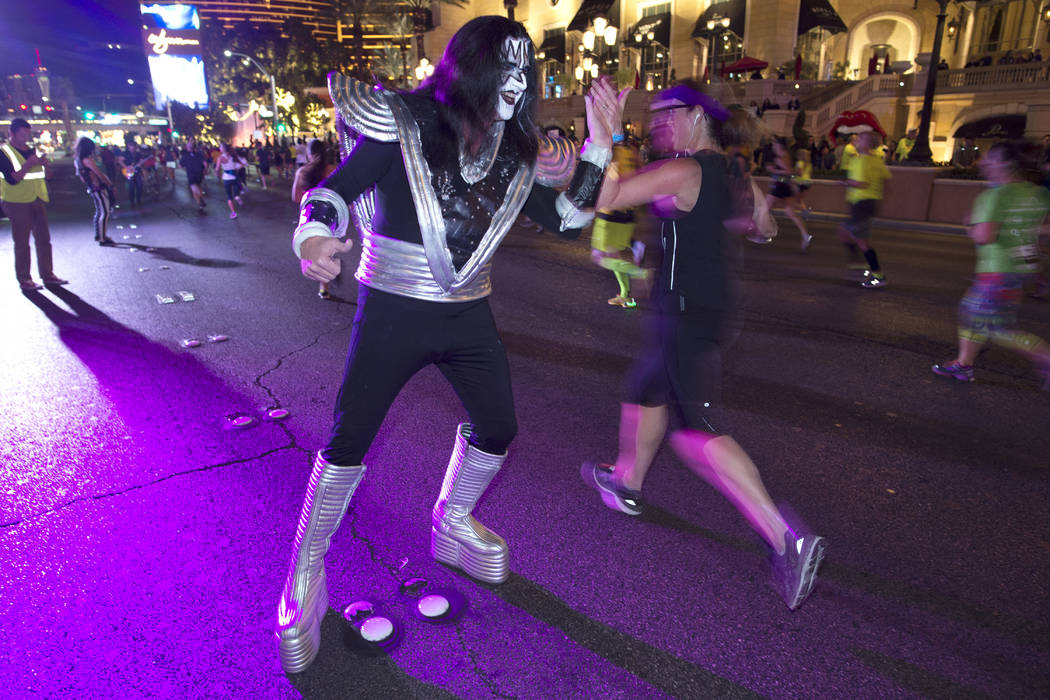 An Ace Frehley character from a Kiss tribute band high-fives participants during the Rock 'n' Roll Las Vegas Marathon. (Sam Morris Las Vegas News Bureau)