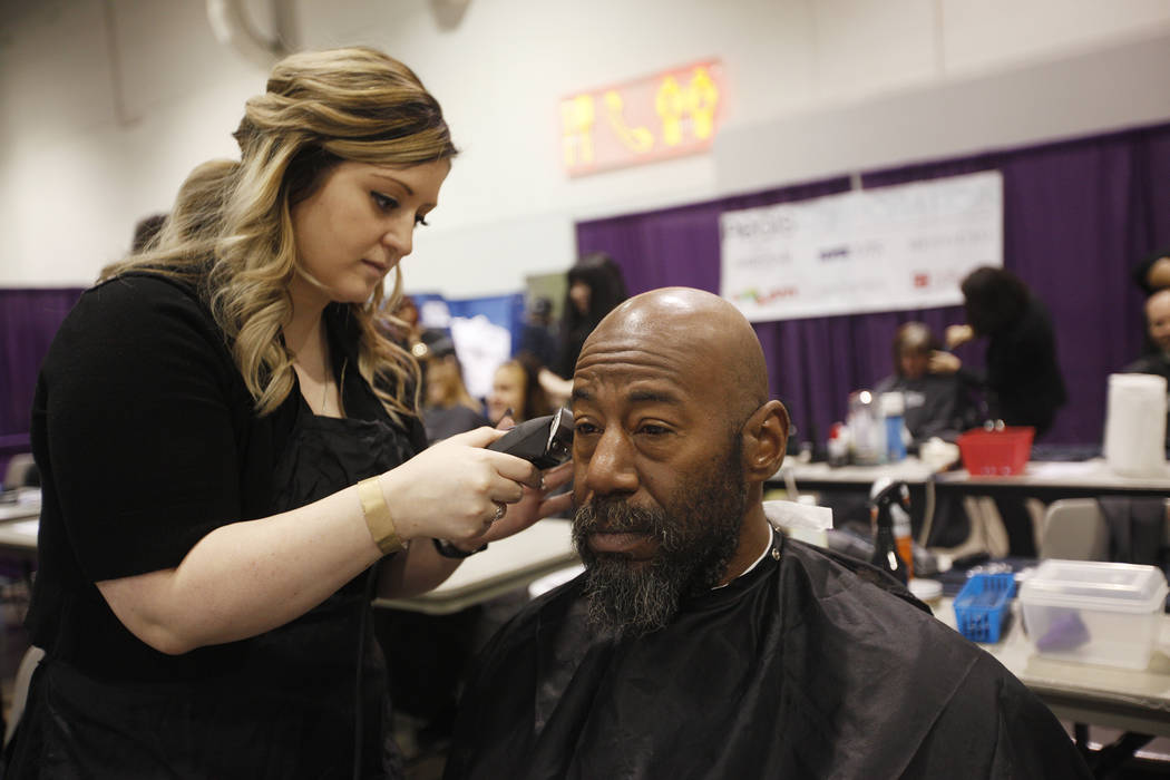 Sheila Rees trims the beard of Brigham Roberts at Project Homeless Connect, a service and resource fair for people who are homeless or at-risk at Cashman Center in Las Vegas, Tuesday, Nov. 14, 201 ...