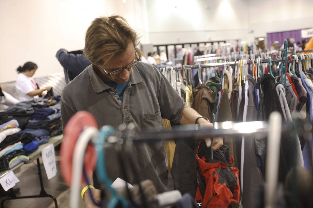 Lawrence Green looks for a jacket at Project Homeless Connect, a service and resource fair for people who are homeless or at-risk at Cashman Center in Las Vegas, Tuesday, Nov. 14, 2017. Rachel Ast ...