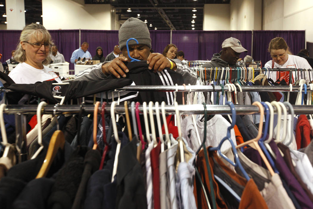 People search for clothes at Project Homeless Connect, a service and resource fair for people who are homeless or at-risk at Cashman Center in Las Vegas, Tuesday, Nov. 14, 2017. Rachel Aston Las V ...