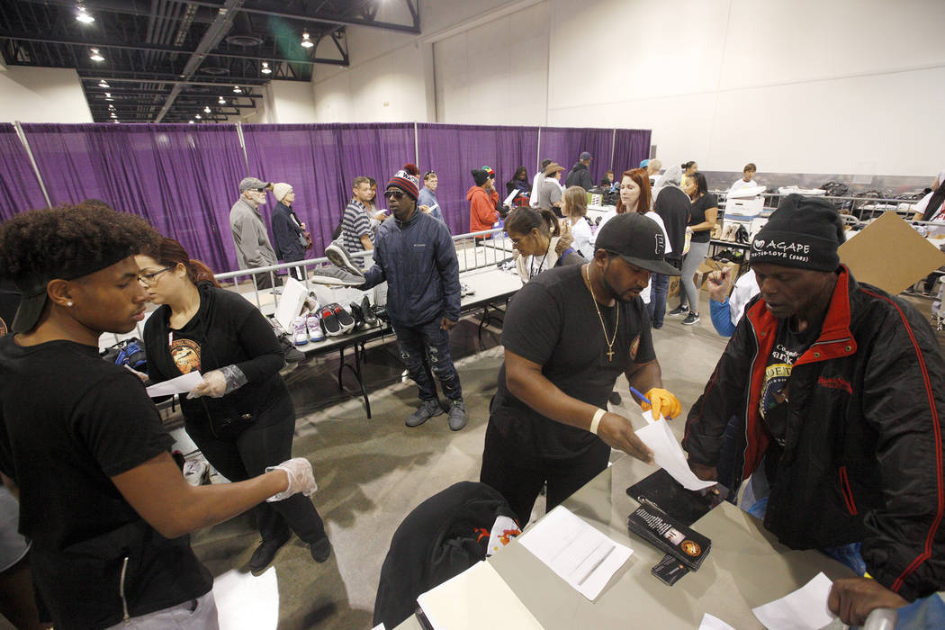 Volunteers work to get shoes to attendees at Project Homeless Connect, a service and resource fair for people who are homeless or at-risk at Cashman Center in Las Vegas, Tuesday, Nov. 14, 2017. Ra ...